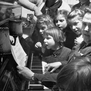 tony-linck-children-singing-around-the-piano-at-orphanage